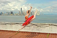 MR. Model relased photo. Ballerina dances and leaps next to the Pacific Ocean, with the city of Panama on tha background.