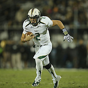 South Florida Bulls quarterback Steven Bench (2) runs during an NCAA football game between the South Florida Bulls and the 17th ranked University of Central Florida Knights at Bright House Networks Stadium on Friday, November 29, 2013 in Orlando, Florida. (AP Photo/Alex Menendez)
