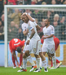 SWANSEA, WALES - Sunday, May 1, 2016: Swansea City's Andre Ayew celebrates scoring the third goal against Liverpool during the Premier League match at the Liberty Stadium. (Pic by David Rawcliffe/Propaganda)