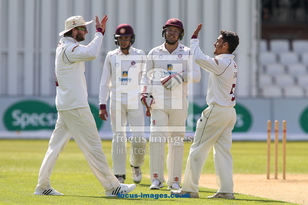 Saif Zaib of Northamptonshire CCC (right) celebrates with skipper Alex Wakely of Northamptonshire CCC after taking a wicket  during day two of the Friendly match at the County Ground, Northampton<br /> Picture by Andy Kearns/Focus Images Ltd 0781 864 4264<br /> 03/04/2017