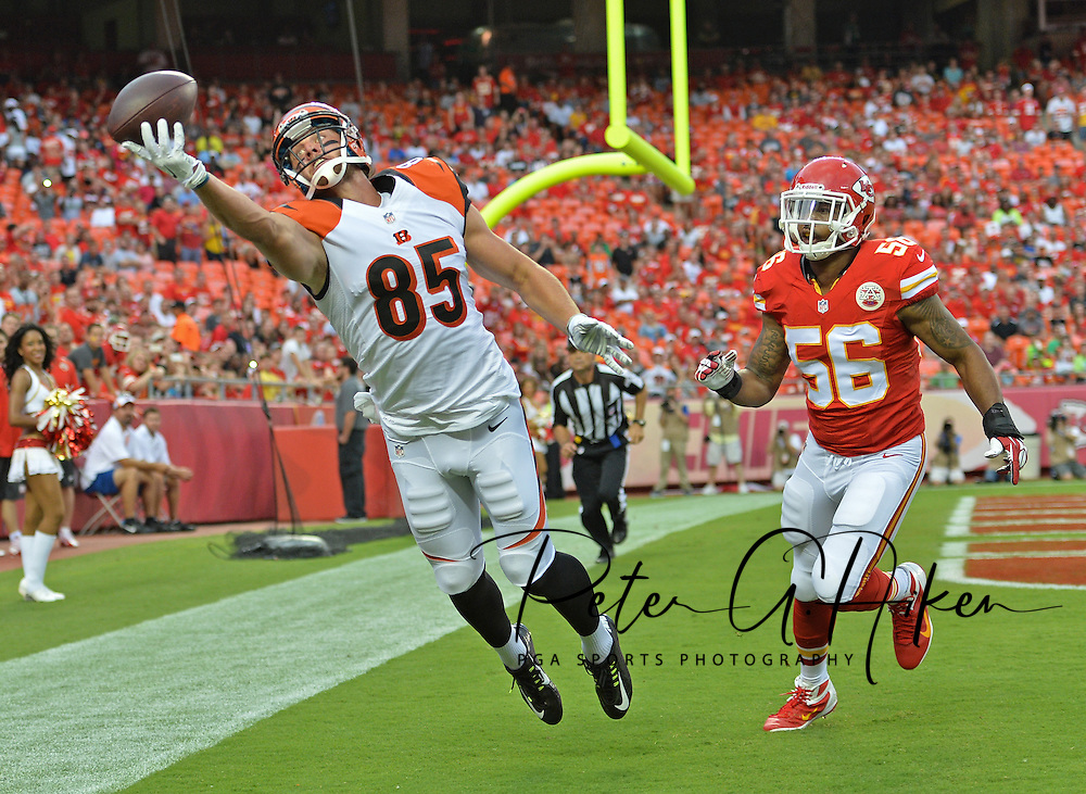 Sports Illustrated -- Tight end Tyler Eifert #85 of the Cincinnati Bengals attempts to pull in the ball against linebacker Derrick Johnson #56 of the Kansas City Chiefs in the end zone at Arrowhead Stadium in Kansas City, Missouri.