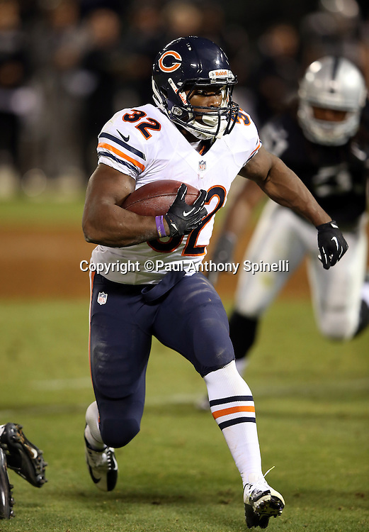Chicago Bears running back Michael Ford (32) runs for a 15 yard touchdown that gives the Bears a 34-20 lead in the fourth quarter during the NFL preseason week 3 football game against the Oakland Raiders on Friday, Aug. 23, 2013 in Oakland, Calif. The Bears won the game 34-26. ©Paul Anthony Spinelli