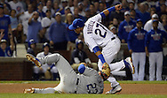 CHICAGO, IL - OCTOBER 16: Addison Russell #27 of the Chicago Cubs tags out Adrian Gonzalez #23 of the Los Angeles Dodgers in the sixth inning during Game 2 of NLCS at Wrigley Field on Sunday, October 16, 2016 in Chicago, Illinois. (Photo by Ron Vesely/MLB Photos via Getty Images)  *** Local Caption *** Mike Montgomery