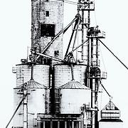 Grain silos in monochrome<br /> lines leading to right