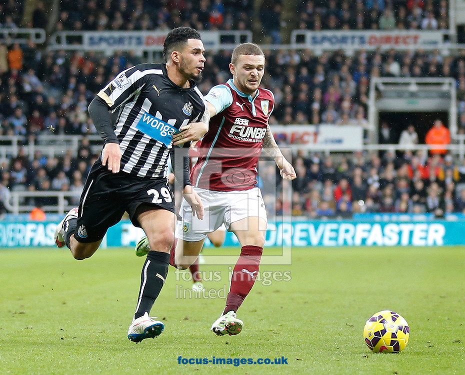 Emmanuel Riviere (l) of Newcastle United and Kieran Trippier of Burnley during the Barclays Premier League match at St. James's Park, Newcastle<br /> Picture by Simon Moore/Focus Images Ltd 07807 671782<br /> 01/01/2015