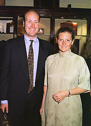 MR & MRS JAMES PALMER-TOMKINSON family friends of the Prince of Wales, at a party in London on 1st September 1998.MJN 68