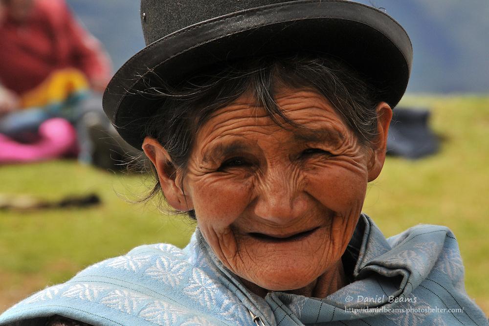 Campesina woman waiting for a bus near Tacacoma, Bolivia