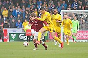 Northampton No 11 Ricky Holmes rides a challenge in the back post in the Sky Bet League 2 match between Northampton Town and Bristol Rovers at Sixfields Stadium, Northampton, England on 9 April 2016. Photo by Nigel Cole.