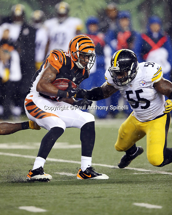 Cincinnati Bengals kick returner Brandon Tate (19) returns a kick while trying to avoid a tackle attempt by Pittsburgh Steelers outside linebacker Arthur Moats (55) during the NFL AFC Wild Card playoff football game against the Pittsburgh Steelers on Saturday, Jan. 9, 2016 in Cincinnati. The Steelers won the game 18-16. (©Paul Anthony Spinelli)