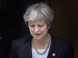© Licensed to London News Pictures. 30/01/2018. London, UK. Prime Minister Theresa May stands on the steps of Number 10 as she says goodbye to Estonian Prime Minister Jüri Ratas in Downing Street. Later Mrs May will travel to China on a three day trade and diplomatic visit.  Photo credit: Peter Macdiarmid/LNP