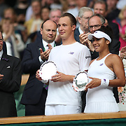 LONDON, ENGLAND - JULY 16: Henri Kontinen of Finland and Heather Watson of Great Britain with their runners-up trophy after the Mixed Doubles Final on Center Court during the Wimbledon Lawn Tennis Championships at the All England Lawn Tennis and Croquet Club at Wimbledon on July 16, 2017 in London, England. (Photo by Tim Clayton/Corbis via Getty Images)
