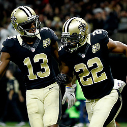 Nov 27, 2016; New Orleans, LA, USA;  New Orleans Saints running back Mark Ingram (22) celebrates after a touchdown with wide receiver Michael Thomas (13) during the first half of a game against the Los Angeles Rams at the Mercedes-Benz Superdome. Mandatory Credit: Derick E. Hingle-USA TODAY Sports