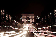 The Arc de Triomphe at night from the Champs Elysee, Paris, France