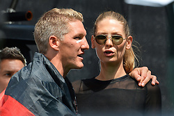 15.07.2014, Brandenburger Tor, Berlin, GER, FIFA WM, Empfang der Weltmeister in Deutschland, Finale, im Bild Bastian Schweinsteiger (GER) li. mit Freundin Sarah Brandner (re.), // during Celebration of Team Germany for Champion of the FIFA Worldcup Brazil 2014 at the Brandenburger Tor in Berlin, Germany on 2014/07/15. EXPA Pictures © 2014, PhotoCredit: EXPA/ Eibner-Pressefoto/ Harzer<br /> <br /> *****ATTENTION - OUT of GER*****