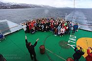 King Neptune poses with first-time Arctic Circle passengers aboard Hurtigruten coastal cruise ship sailing along northwest coast of Norway.