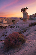 Sunrise over the alien landscape of hoodoos and toadstools at Stud Horse Point near Page, Arizona.