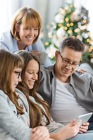 Family using tablet PC together at home