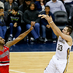 Dec 30, 2013; New Orleans, LA, USA; New Orleans Pelicans power forward Ryan Anderson (33) shoots over Portland Trail Blazers power forward LaMarcus Aldridge (12) during the first half of a game at the New Orleans Arena. Mandatory Credit: Derick E. Hingle-USA TODAY Sports