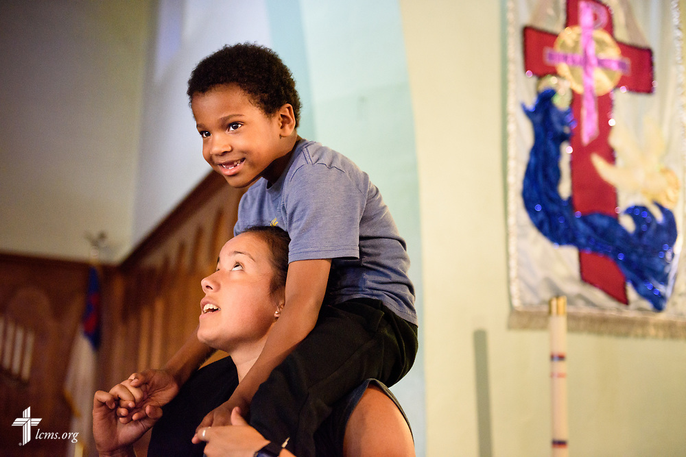 Kristin Boos holds a Kobiee Hooper at the end of vacation Bible camp at East Bethlehem Lutheran Church, Detroit, Mich., on Wednesday, June 21, 2017, in Detroit. LCMS Communications/Erik M. Lunsford