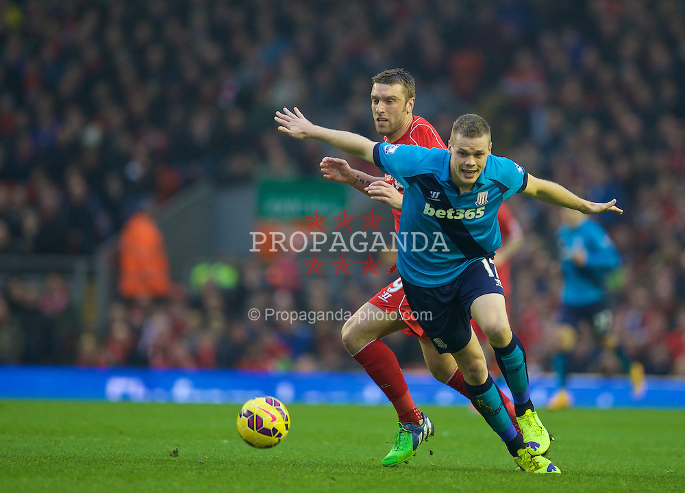 LIVERPOOL, ENGLAND - Saturday, November 29, 2014: Liverpool's Rickie Lambert in action against Stoke City's captain Ryan Shawcross during the Premier League match at Anfield. (Pic by David Rawcliffe/Propaganda)