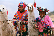 Peruvian children with llamas, Peru, South America