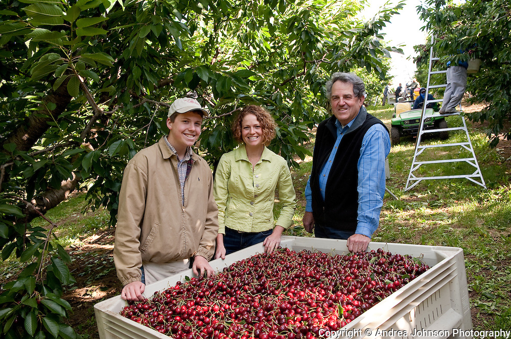 3 generations of farmers:  Bob Baily, daughter Brend, grandson Gus,  Orchard View Farms cherry harvest, The Dalles, Columbia River Gorge, Oregon