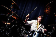 Young drummer from house of cain shot using an off camera flash