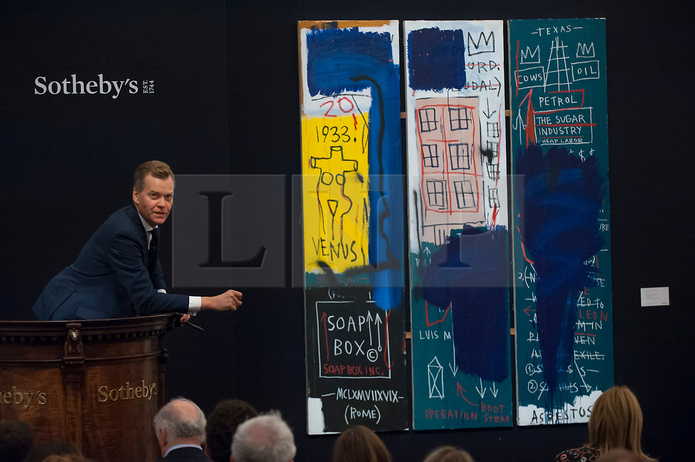 """© Licensed to London News Pictures. 28/06/2017. London, UK. """"Untitled"""", 1983, by Jean-Michel Basquiat sold for a hammer price of GBP5.63m (estimate GBP4-6m)at Sotheby's Contemporary Art evening sale in New Bond Street, which featured pioneering works from the Pop Art genre. Photo credit : Stephen Chung/LNP"""