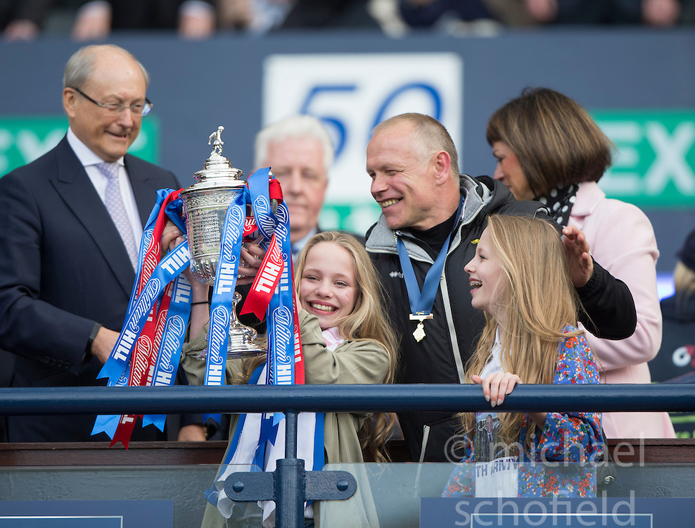 Inverness Caledonian Thistle's manager John Hughes manager with his twins. lifts the cup. Falkirk 1 v 2 Inverness CT, Scottish Cup final at Hampden.