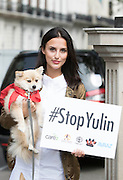 UNITED KINGDOM, London: 07 June 2016 Made in Chelsea star Lucy Watson and her dog show their support outside the Chinese Embassy earlier today as they join other animal campaigners to hand in a petition against China's Yulin dog meat festival. Rick Findler / Story Picture Agency