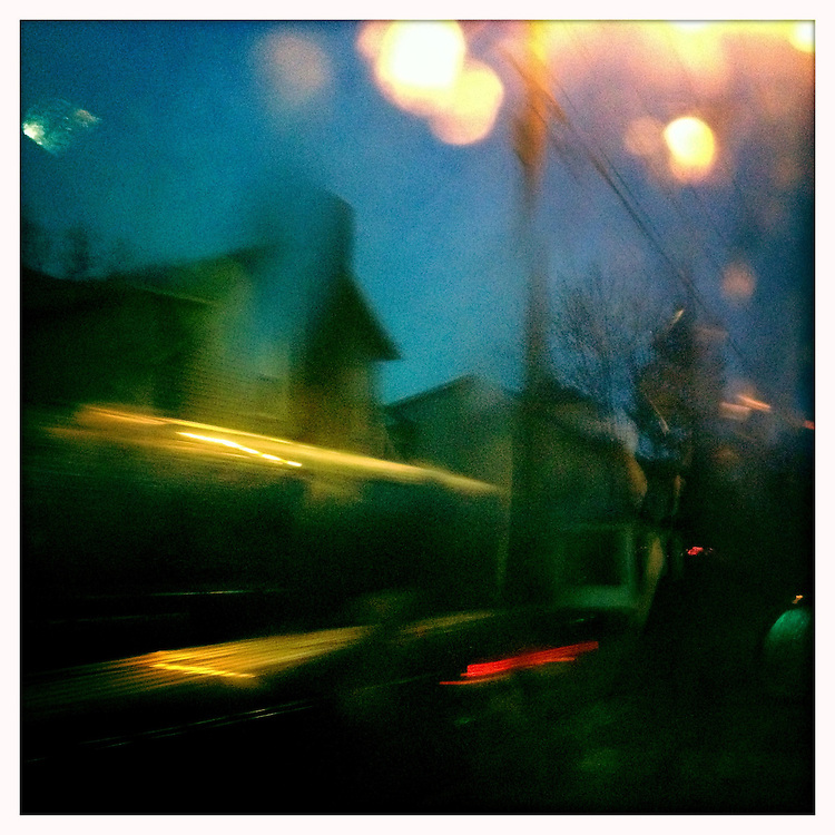 Rain drops fog up the car window, while riding down East State street on a rainy January day.