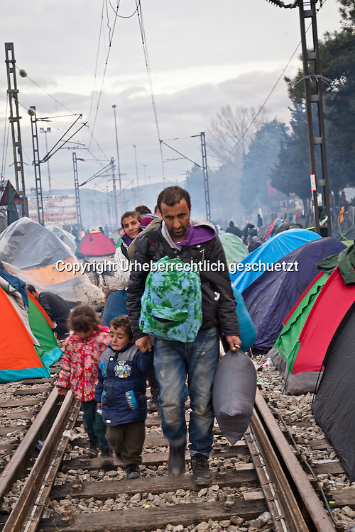 Greece, Idomeni, Refugees on their way to Europe - Eye of a Needle, Idomeni<br /> <br /> Family from Syria is leaving the Idomeni camp.<br /> <br /> Nadeloehr nach Nordeuropa Idomeni, der Grenzuebergang ist seit Tagen gesperrt,. <br /> Es ensteht im provisorischen Fluechtlingslager in Idomeni eine ngespannte Lage. <br /> Daueregen und Kaelte machen vor allem den Familien mit kleinen Kindern zu schaffen. <br /> <br /> Idomeni, is the eye of a needle for getting to nothern Europe. <br /> The FYRO macedonian authorities, closed the border from Greece completely. The situation close to the border gets more and more difficult. The People have to sleep outside or in small tents. <br /> Heavy rainfalls and cold nights are treating the refugees badly. Some already stayed up to ten nights at Idomeni. There is not enough food and supplies to help about 14.000 refugees.<br /> <br /> <br /> <br /> keine Veroeffentlichung unter 50 Euro*** Bitte auf moegliche weitere Vermerke achten***Maximale Online-Nutzungsdauer: 12 Monate !! <br /> <br /> for international use:<br /> Murat Tueremis<br /> C O M M E R Z  B A N K   A G , C o l o g n e ,  G e r m a n y<br /> IBAN: DE 04 370 800 40 033 99 679 00<br /> SWIFT-BIC: COBADEFFXXX