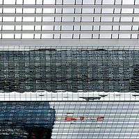 The abstract photograph of skyscraper reflections in a skyscraper.