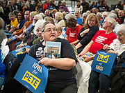 08 DECEMBER 2019 - CORALVILLE, IOWA: CINDY TROFF, from Coralville, (front row, far right) holds a copy of Pete Buttigieg's book while she waits for Buttigieg to enter his campaign event in Corralville. Buttigieg, the mayor of South Bend, Indiana, is running to be the Democratic nominee for President in the 2020 election. Iowa traditionally holds the first presidential selection event of the 2020 election cycle. The Iowa Caucuses are on Feb. 3, 2020.    PHOTO BY JACK KURTZ