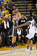 Golden State Warriors guard Klay Thompson (11) shoots a three pointer against the San Antonio Spurs during Game 2 of the Western Conference Quarterfinals at Oracle Arena in Oakland, Calif., on April 16, 2018. (Stan Olszewski/Special to S.F. Examiner)