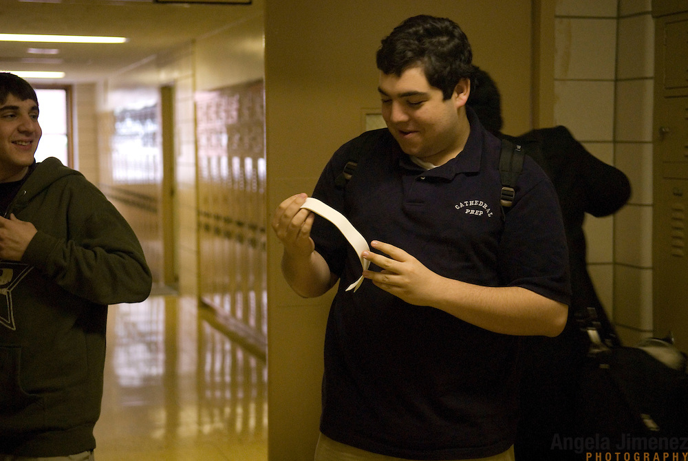 Date: 5/15/2008..Desk: CTY..Slug: ..Assign Id: ....Ralph Edel, 17,  a senior at the Cathedral Preparatory Seminary in Elmhurst, Queens, holds a clerical collar given to him to wear at that evening's convocation ceremony at the diocese?s college seminary residence (Cathedral Seminary Residence in Douglaston, New York) on May 15, 2008. Edel is one of two graduating seniors who will go on to Douglaston next year, the next step in a long path towards becoming a Catholic priest. At left is senior Justin Marino. ....Photo by Angela Jimenez for The New York Times ..photographer contact 917-586-0916 A story, published in The New York Times, about the last existing diocesan day high school, located in Queens, New York, in the United States for young men who are considering the vocation of the Catholic priesthood.