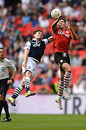 Josh Brownhill of Barnsley looks to win a header in the air against Ben Thompson of Millwall during the Sky Bet League 1 Play-off Final between Barnsley and Millwall at Wembley Stadium, London<br /> Picture by Richard Blaxall/Focus Images Ltd +44 7853 364624<br /> 29/05/2016