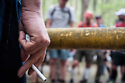 Laz, the cigarette, the yellow gate and runners await the start of the Barkley Marathons.