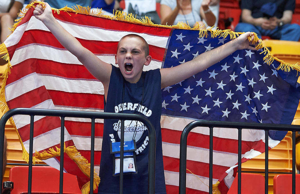 A young American fan cheers during karate competition at the 2013 Maccabi Games in Israel.  © 2013 Shelley Lipton.