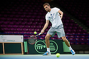 Jerzy Janowicz of Poland while training session four days before the BNP Paribas Davis Cup 2014 between Poland and Croatia at Torwar Hall in Warsaw on March 31, 2014.<br /> <br /> Poland, Warsaw, March 31, 2014<br /> <br /> Picture also available in RAW (NEF) or TIFF format on special request.<br /> <br /> For editorial use only. Any commercial or promotional use requires permission.<br /> <br /> Mandatory credit:<br /> Photo by &copy; Adam Nurkiewicz / Mediasport