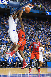 Kentucky forward Marcus Lee dunks over Ole Miss guard Martavious Newby in the second half. The University of Kentucky hosted Ole Miss, Saturday, Jan. 02, 2016 at Rupp Arena in Lexington.