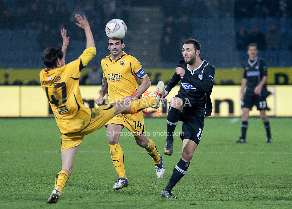 14.12.2011, UPC Arena, Graz, AUT, UEFA Europa League , Sturm Graz vs AEK Athen FC, im Bild Darko Bodul (SK Puntigamer Sturm Graz, #19) gegen Mavroudis Bougaidis (AEK Athen FC, Defender, #47) und Grigoris Makos (AEK Athen FC, Midfield, #14) // during UEFA Europa League football game between Sturm Graz and AEK Athens FC at UPC Arena in Graz, Austria on 14/12/2011. EXPA Pictures © 2011, PhotoCredit: EXPA/ E. Scheriau