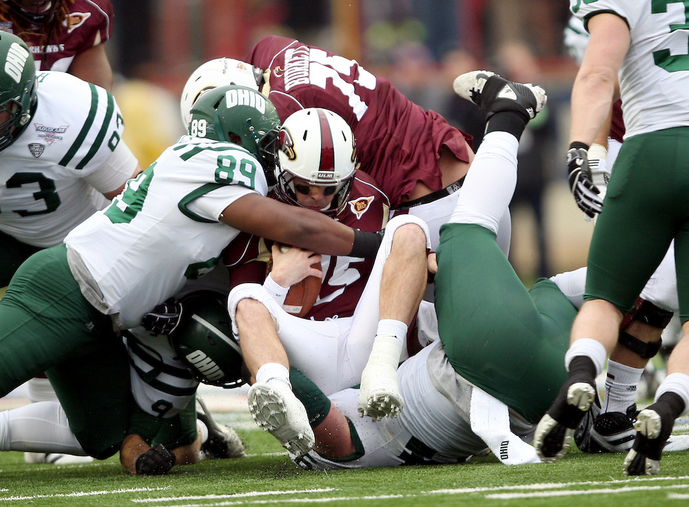 Louisiana-Monroe quarterback Kolton Browning (15) is sacked by Ohio defenders during the first quarter of the Independence Bowl NCAA college football game in Shreveport, La., Friday, Dec. 28, 2012.