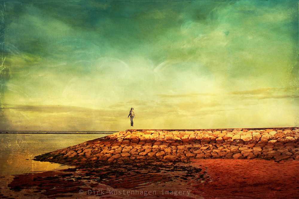 Manipulated picture with man levitating over a levee