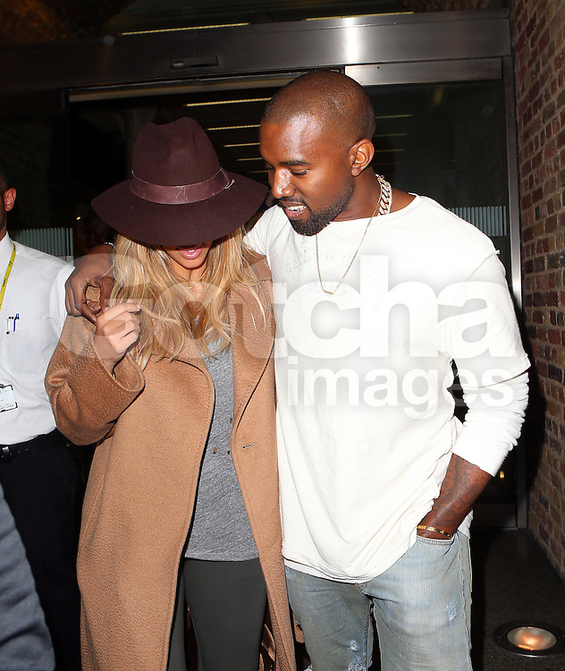 Kim Kardashian and Kanye West arriving St Pancras Eurostar in London, UK. 28/09/2013<br />BYLINE MUST READ : JAMESY/GOTCHA IMAGES<br /><br />Copyright by &copy; Gotcha Images Ltd. All rights reserved.<br />Usage of this image is conditional upon the acceptance <br />of Gotcha Images Ltd, terms and conditions available at<br />www.gotchaimages.com