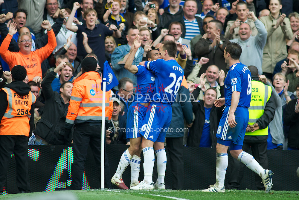 LONDON, ENGLAND - Sunday, May 9, 2010: Chelsea's Ashley Cole celebrates after making it 8-0 against Wigan Athletic to gaurentee that Chelsea will win the Premier League during the final Premiership match of the season at Stamford Bridge. (Pic by Gareth Davies/Propaganda)