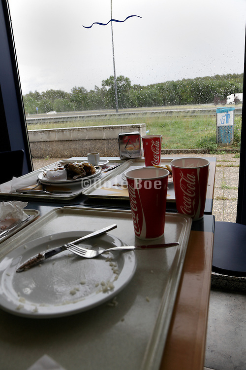 abandoned table at a fastfood roadside restaurant