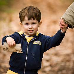 A young boy holds up some birch bark in Gulf Brook Ravine in Pepperell, MA.