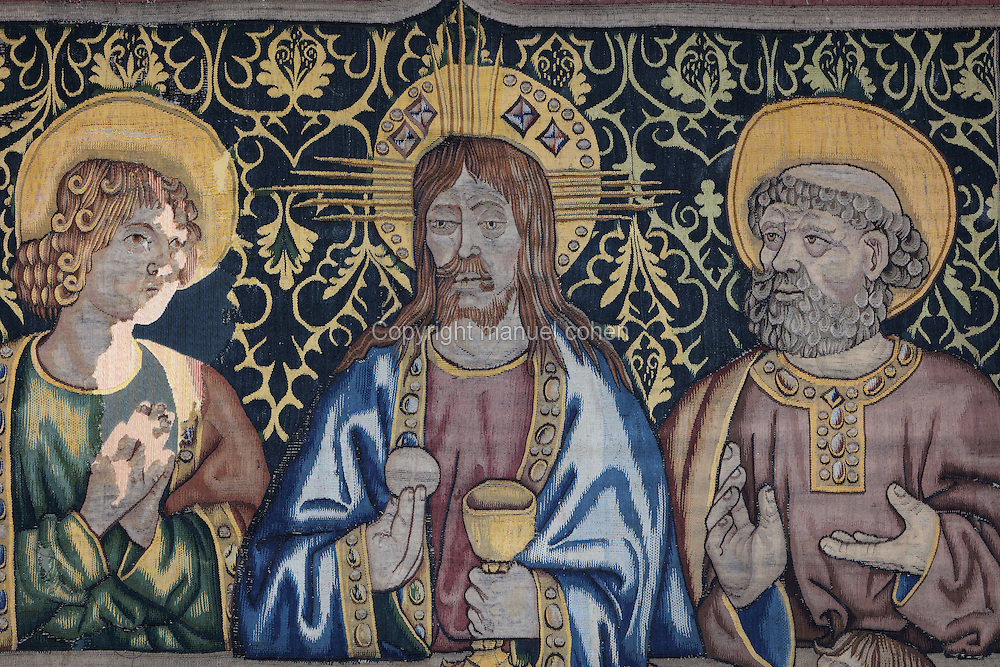 Detail of Jesus holding the bread and wine with 2 apostles, on the Tapestry of the Last Supper, 15th century, by an unknown artist, in linen, wool, silk and gold thread, in the collection of the Museum of Tortosa Cathedral, in the Cathedral of St Mary, designed by Benito Dalguayre in Catalan Gothic style and begun 1347 on the site of a Romanesque cathedral, consecrated 1447 and completed in 1757, Tortosa, Catalonia, Spain. Picture by Manuel Cohen