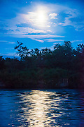 Rising moon above the Bystraya river, Kamchatka, Russia